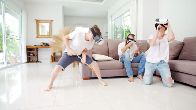 Family at home using VR helmets video