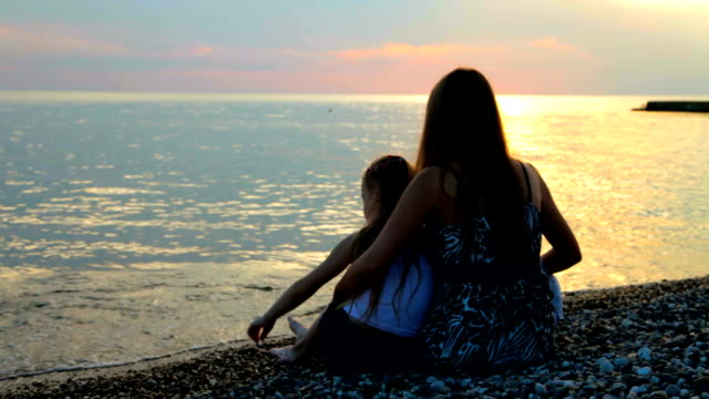 family at sunset video