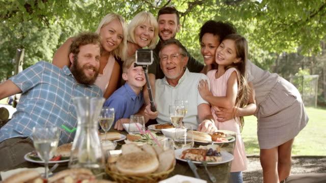 SLO MO Family at the picnic table making selfies video