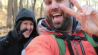Family Backpacking Hiking with Baby in Autumn Forest video