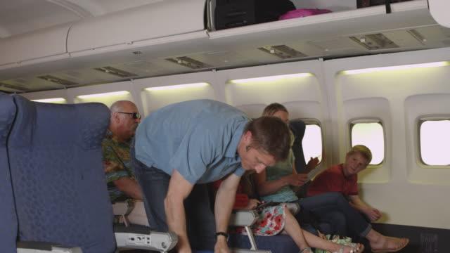 Family boarding a plane video