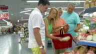 Family buying cheese in the store video