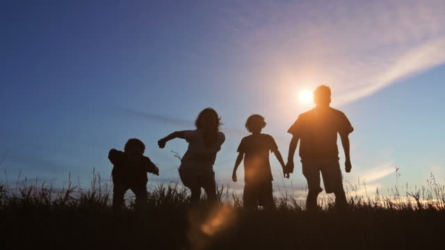 Family celebrate joy at sunset video