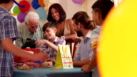 Family Celebrating Child Birthday With Happy Friends And Clapping Hands video