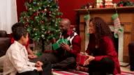 Family celebrating Christmas video