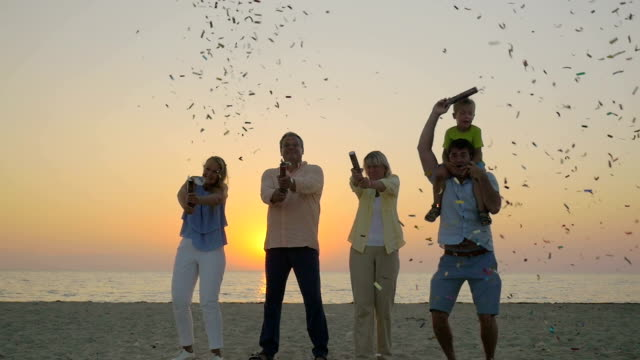 Family celebration with confetti on the beach video