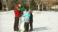 Family conrstucts a snowman video