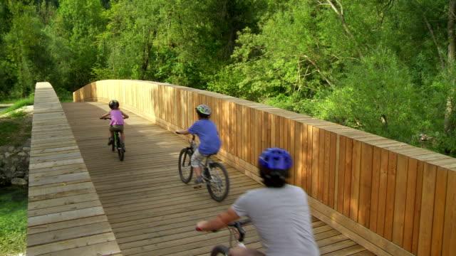 Family Cycling Across The Bridge video