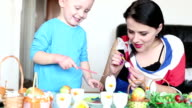 Family Decorating Easter Eggs video