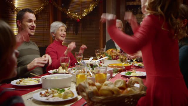 Family doing a funny dance at the festive table video