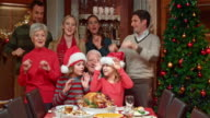 Family doing a funny dance by the Christmas tree video