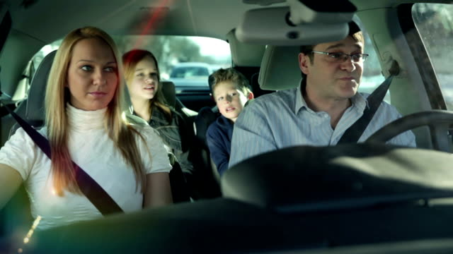 HD WIDE: Family driving in a car video