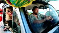Family driving toward summer holiday video