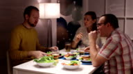 Family eating at the table and talk video