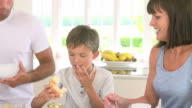 Family Eating Breakfast In Kitchen Together video