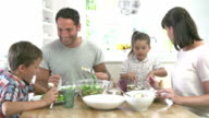 Family Eating Meal Around Kitchen Table Together video