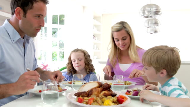 Family Eating Meal At Home Together video