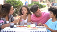 Family Eating Meal At Outdoor Restaurant Together video