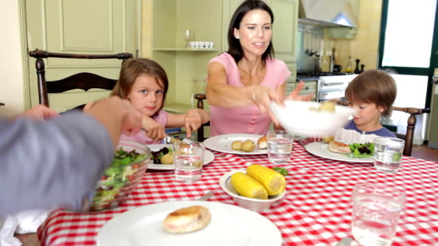 Family Eating Meal Together In Kitchen video