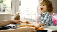 Family Eating Pizza at Home Out of Pizza Box video
