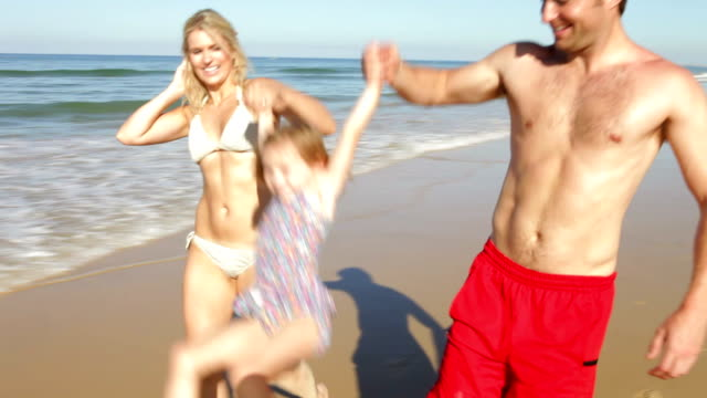 Family Enjoying Beach Holiday Together video