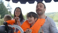 Family Enjoying Day Out In Boat On River Shot In Slow Motion video