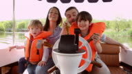 Family Enjoying Day Out In Boat On River Shot On R3D video