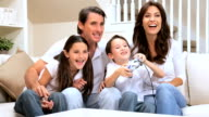 Family Enjoying Games Console video