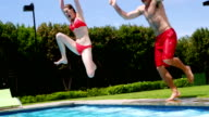 Family enjoying in swimming pool video