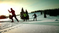 SLO MO family enjoying on a cross country skiing track video