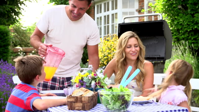Family Enjoying Outdoor Barbeque In Garden video