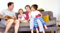 Family Enjoying Sofa Cuddles video