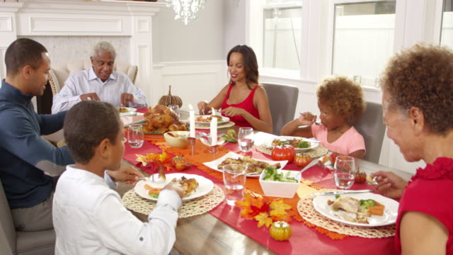 Family Enjoying Thanksgiving Meal At Table Shot On R3D video