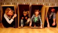 Family fun. hiding in cardboard boxes. video