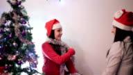 family fun near the Christmas tree video