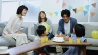 Family Gathered Around Birthday Cake video