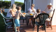 Family gathering outside and dining video