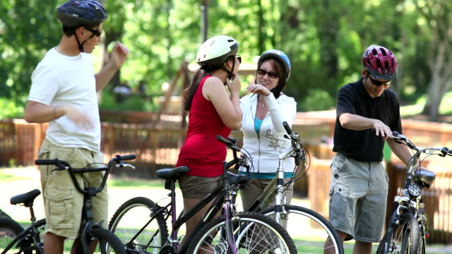 Family getting ready for bicycle ride video