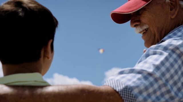 Family Grandpa Teaching Boy To Fly Kite Slowmotion video