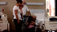 Family greets elderly woman in hospital video