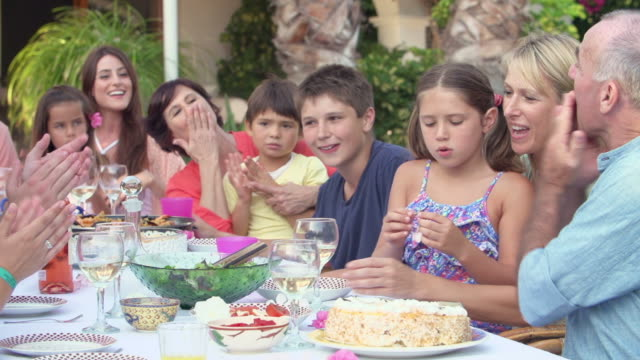 Family Group Celebrating Birthday On Terrace In Slow Motion video