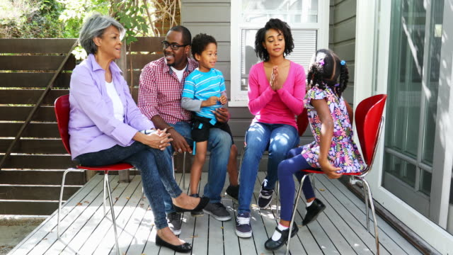 Family Group Enjoying Time Together Sitting Outdoors video