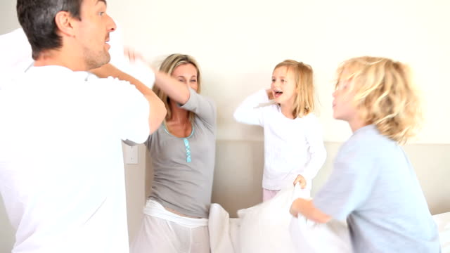 Family having a pillow fight video