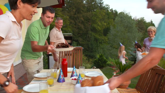 HD CRANE: Family Having Barbecue Birthday Party video