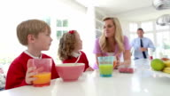 Family Having Breakfast In Kitchen Together video
