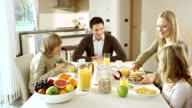 Family having breakfast together video