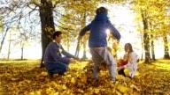 SLO MO Family having fun in autumn park video