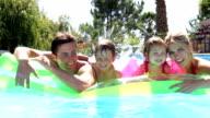Family Having Fun In Swimming Pool video