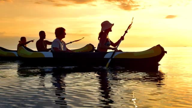 TS Family Having Fun Kayaking At Sunset video