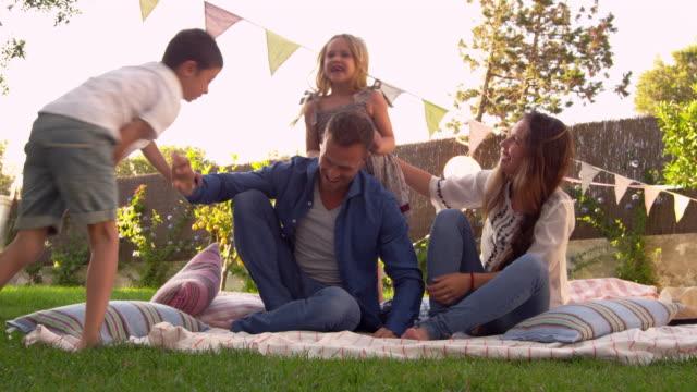 Family Having Fun On Blanket In Garden video